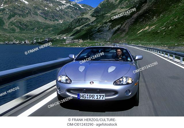 Car, Jaguar XKR, Convertible, model year 2000-2002, silver, diagonal from the front, frontal view, driving, country road, open top, Mountains, landsapprox