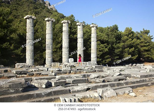 Tourist at the Temple of Athena in the ancient city of Priene, Soke, Aydin Province, Turkey, Europe