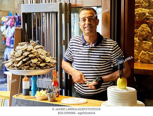 Waiter opening oysters, Bar Restaurante Portaletas, Parte Vieja, Old Town, Donostia, San Sebastian, Gipuzkoa, Basque Country, Spain
