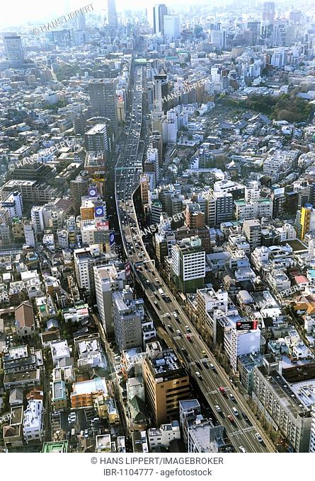 View from the observation deck in Roppongi Hills building over Tokyo, main street towards Shibuya, Tokyo, Japan, Asia