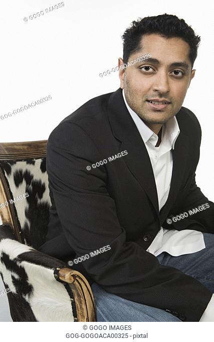Man sitting in armchair