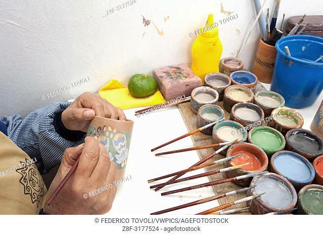 Working in the workshop of the ceramicist Pablo Seminario. Peru