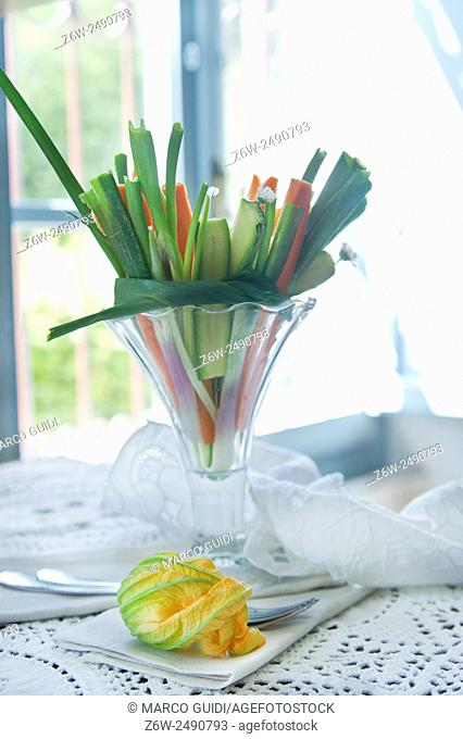Preparation and presentation of mixed vegetables for garnish