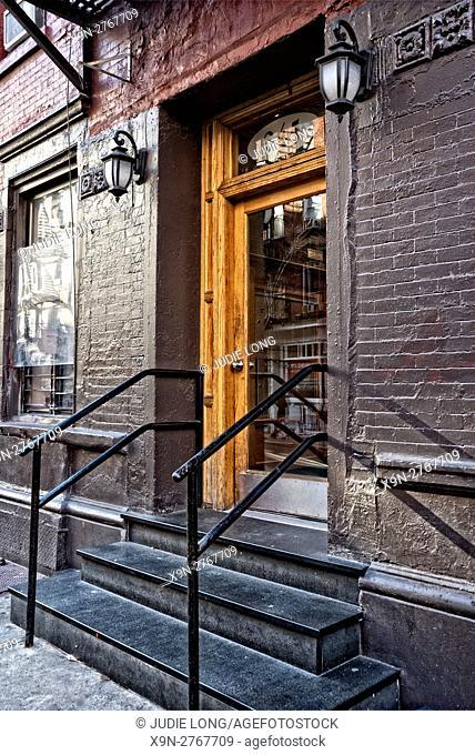 New York City, Manhattan, Soho. Doorway leading to a Soho Tenement Apartment Building