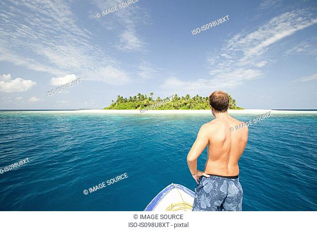 Man with boat, Baughagello Island, South Huvadhu Atoll, Maldives