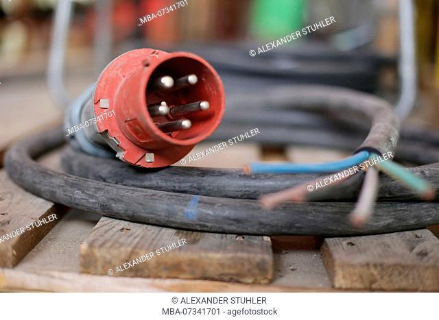 Power line with a plug