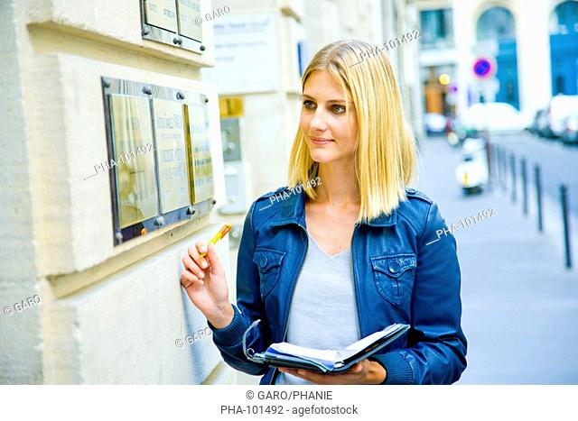 Woman watching health professional brass plates