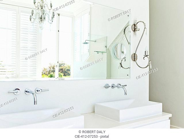 Sinks and mirror in modern bathroom