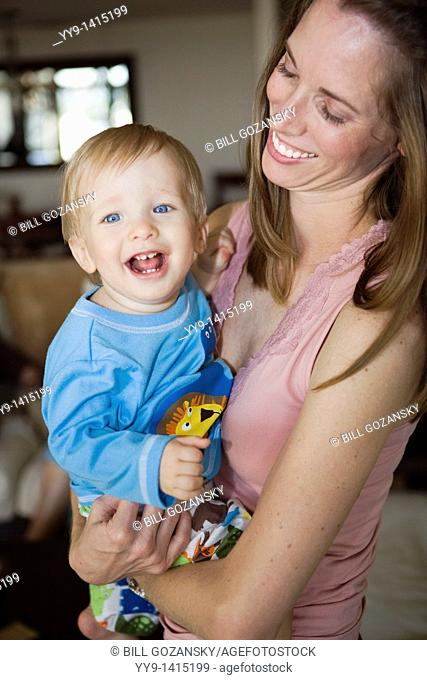 Young mother holding smiling baby boy - Fort Lauderdale, Florida USA