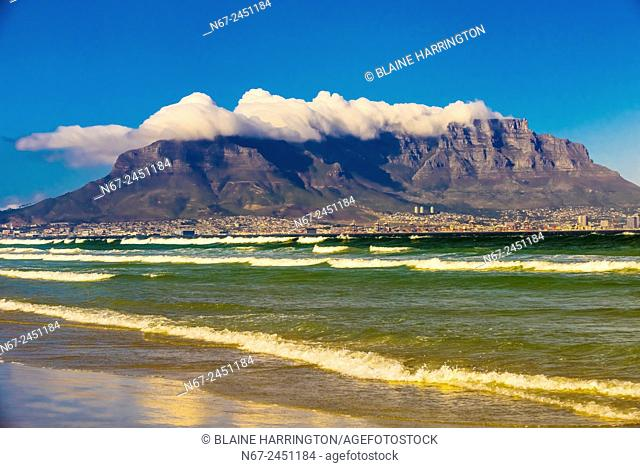 View of Cape Town and Table Mountain and Lion's Head Peak from the beach at Milnerton, South Africa
