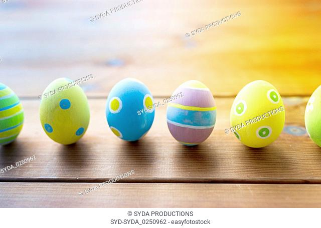 colored easter eggs on wooden surface
