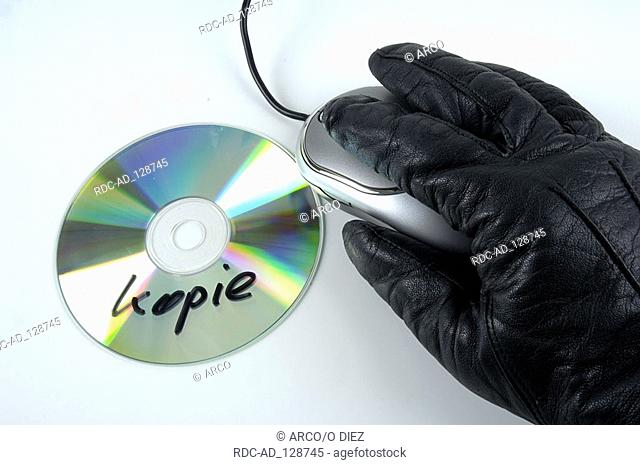 Computer crime cd pirated copy hand in glove computer mouse