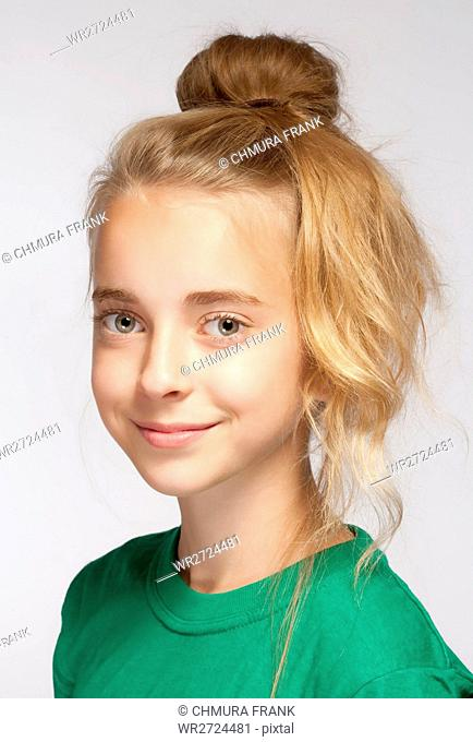 Portrait of a Beautiful Young Girl with Long Blond Hair