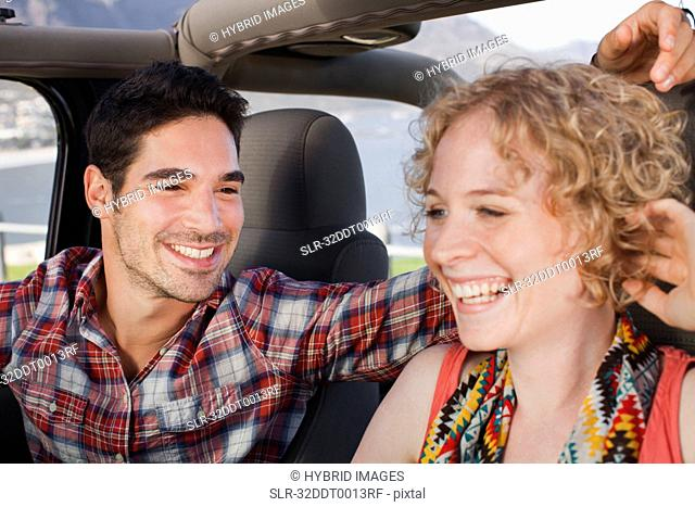 Couple riding in jeep together