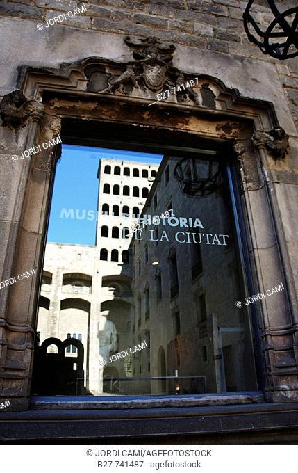 Reflections of Palau Reial, in a window of the Museu d'Historia de la Ciutat, Plaça del Rei, Gothic quarter, Barcelona, Catalonia, Spain