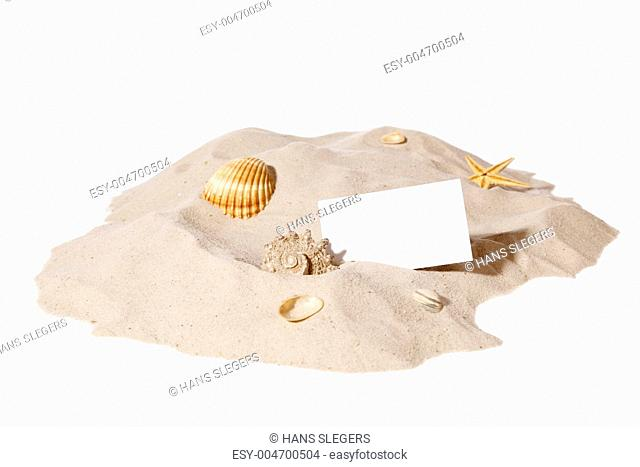 beach concept with pile of sand and a blank card