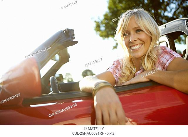 Girl leaning out of her electric car