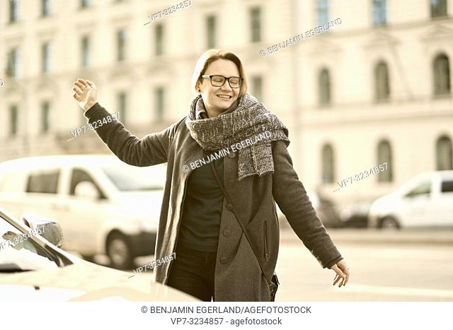 woman dancing at street in city Munich, Germany