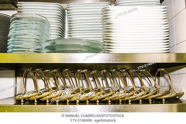 Plates and accessories in restaurant kitchen