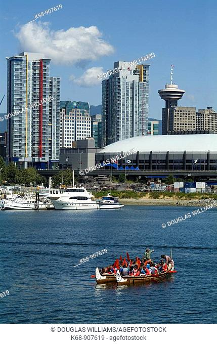 canoes in False Creek, with GM Place in background, Vancouver, BC, Canada.GM Place is a venue for the 2010 Winter Olympics