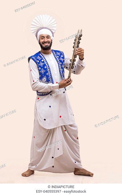 Portrait Of Sikh man Holding A Chimta