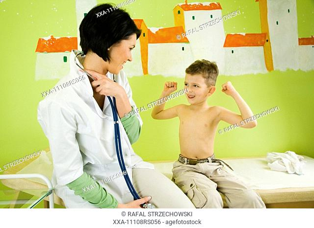 doctor talking with small patient