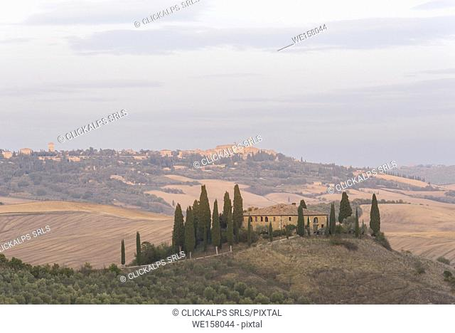 San Quirico d'Orcia, Province of Siena, Orcia Valley, Tuscany, Italy, Europe. View of Podere Belvedere at sunset with Pienza on the background