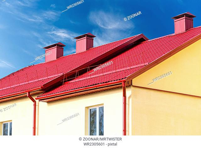 home with new red tiled roof