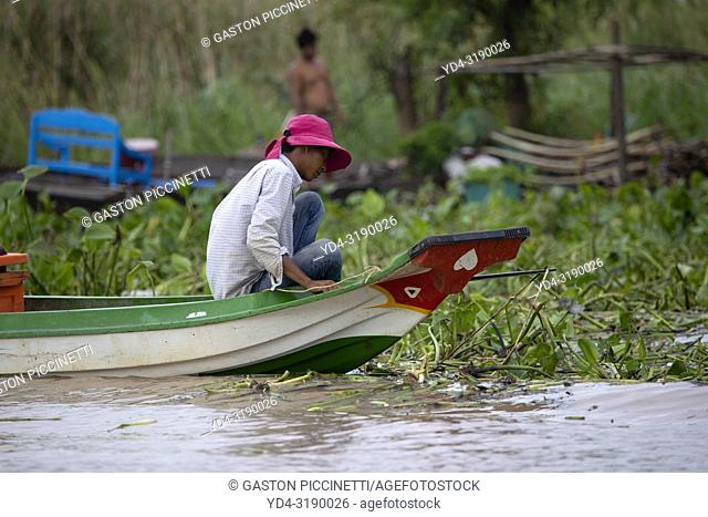 Woman on the boat, Chang Kneas floating village, Siem Reap Province, Cambodia. Chang Kneas, is one of the more than 170 villages surrounding the Tonle Sap Lake