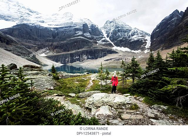 Female hiker at Lake Oesa, Yoho National Park; British Columbia, Canada