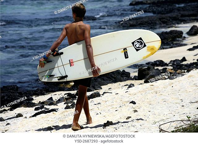 young surfer; blue Bay beach, Grand Port, Mauritius, Africa