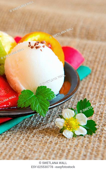 Ice cream with strawberry isolated on brown cloth background.Mixed fruit ice