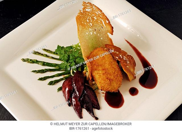 Roasted duck liver with poached baked egg, wild asparagus and red onion confit served on a white plate, food, haute cuisine