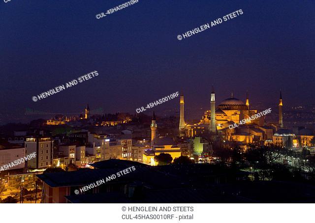 Aya Sofya at dusk with Bosphorus bridge in background, Istanbul, Turkey