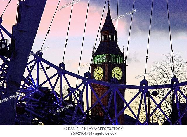 View of Big Ben seen through the London Eye at sunset in Westminster, London, England