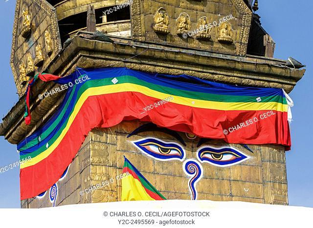 Nepal, Kathmandu, Swayambhunath. The All-Seeing Eyes of the Buddha Gaze out from above the Stupa of Swayambhunath. Below the eyes is the Nepali number one