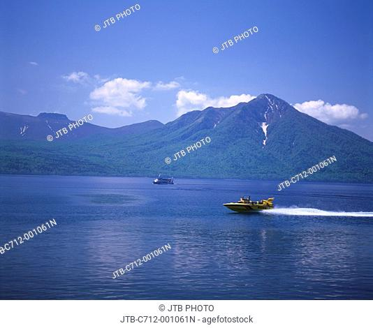 Ship Lake Shikotsu Lake Chitose Hokkaido Japan Blue sky Clouds Mountain Unmelted snow Ship Wave