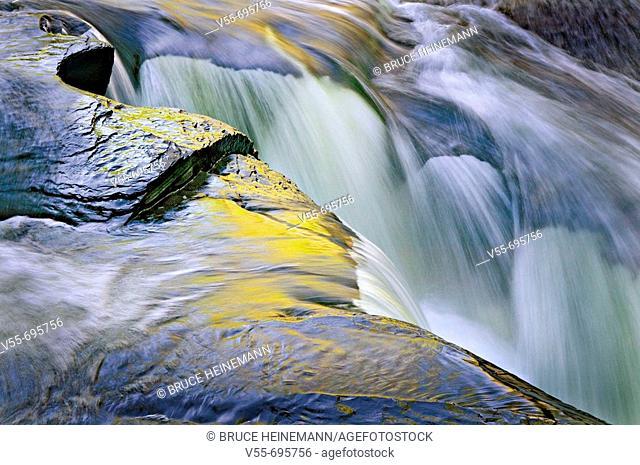 Small waterfall cutting through rocks at Preseque Isle Falls, Porcupine Mt. Wilderness State Park, Upper Peninsula Michigan, USA