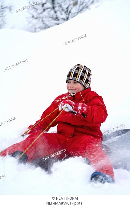 Boy playing on snow