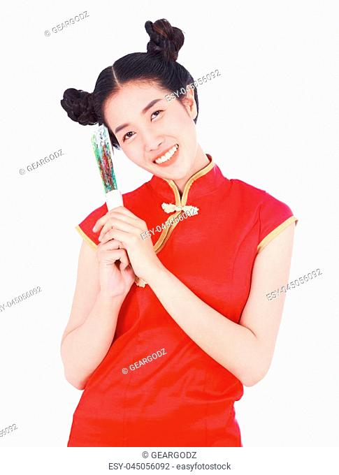 926a16a6b woman wearing chinese cheongsam dress and holding a chinese fan isolated on  a white background