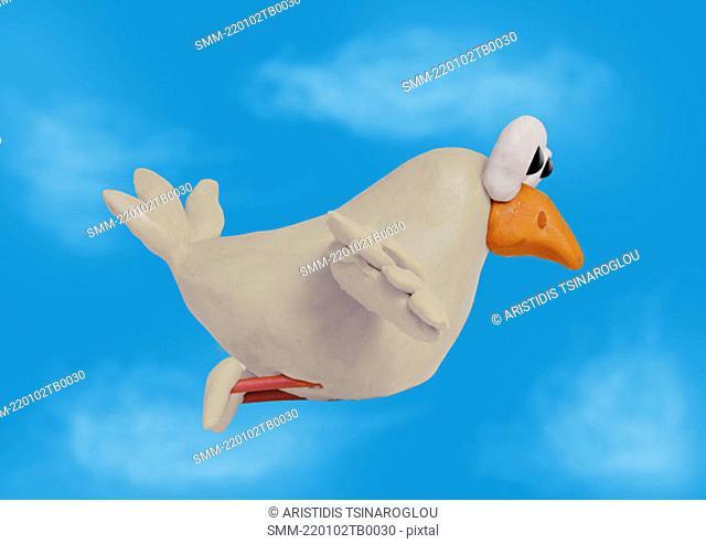 White bird flying in sky