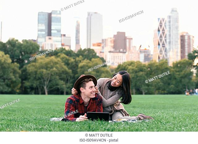 Mid adult couple on picnic blanket in Central Park, New York, USA