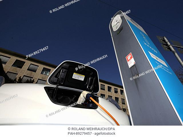 An electric car charges at a power station of Innogy in Essen, Germany, 17 March 2017. Germany's power suppliers campaign for the expansion of electric mobility...
