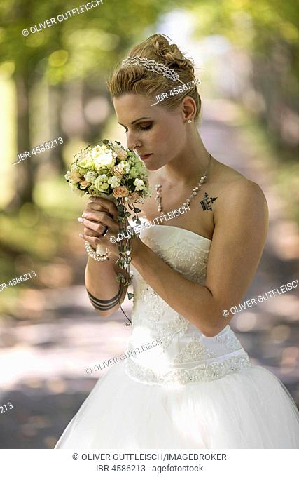 Young blonde woman in a white wedding dress, Switzerland