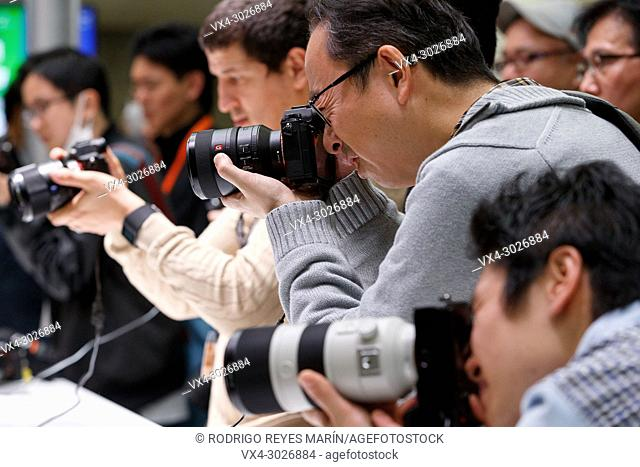 March 3, 2018, Yokohama, Japan - Visitors try out the new cameras Sony a7 III at the CP+ Camera & Photo Imaging Show 2018 in Pacifico Yokohama