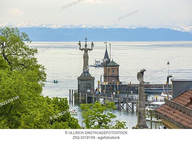 View over the lighthouse and the statue of the Imperia by Peter Lenk, as well as the Zeppelin memorial in the harbour of Konstanz at Lake Constance