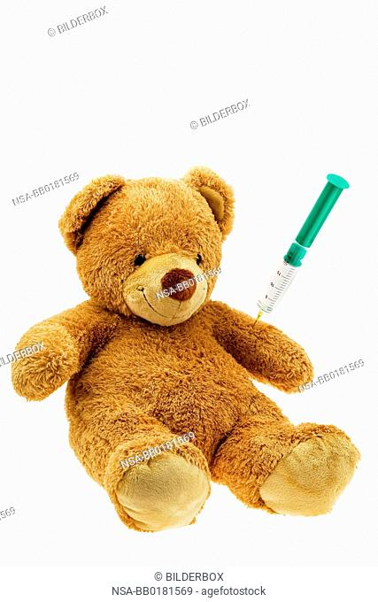 A Teddy gets an injection.Vaccination and syringe