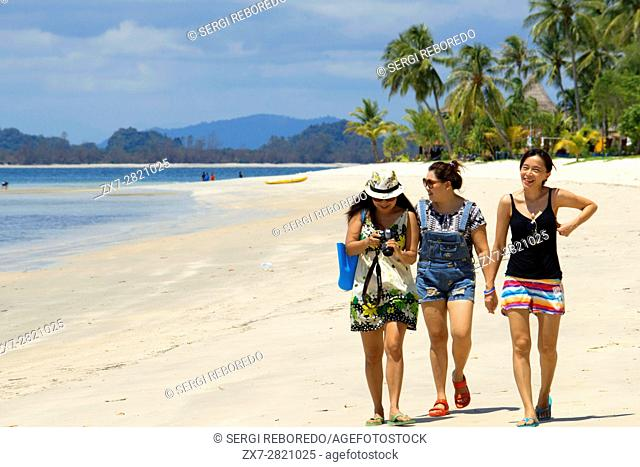 Asian girls in the beach in Koh Mook island of Ko Muk or , Thailand, Southeast Asia, Asia. Sivalai Beach Resort. Koh Mook (Muk) is a small rocky island off the...