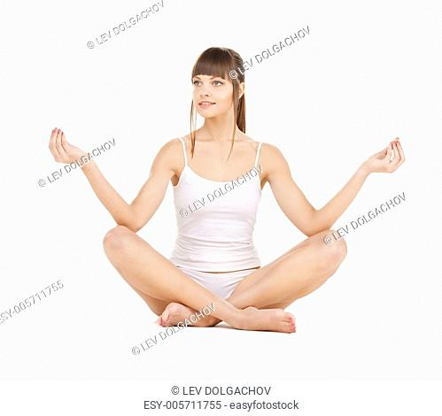 sporty woman in cotton underwear practicing yoga lotus pose
