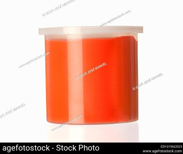 Container of red paint